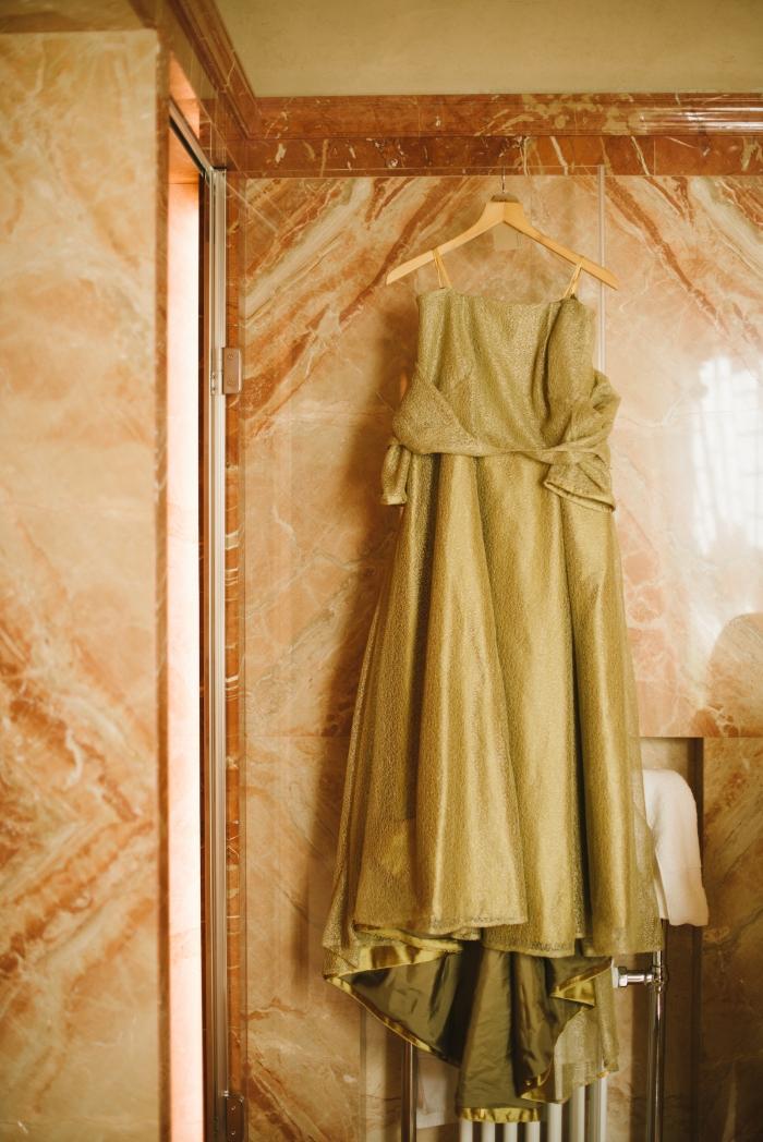 Paula's dress hanging marble wall